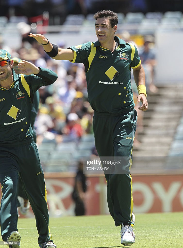 Australia's fast bowler Mitchell Starc (R) celebrates taking the wicket of Kieran Powell during the one-day international cricket match between Australia and the West Indies at the WACA ground on February 1, 2013. AFP PHOTO/Tony ASHBY IMAGE