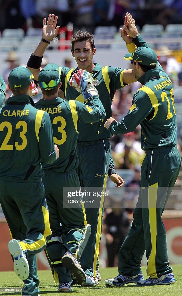Australia's fast bowler Mitchell Starc ( C hatless) celebrates taking the wicket of Kieran Powell during the one-day international cricket match between Australia and the West Indies at the WACA ground on February 1, 2013. AFP PHOTO/Tony ASHBY IMAGE