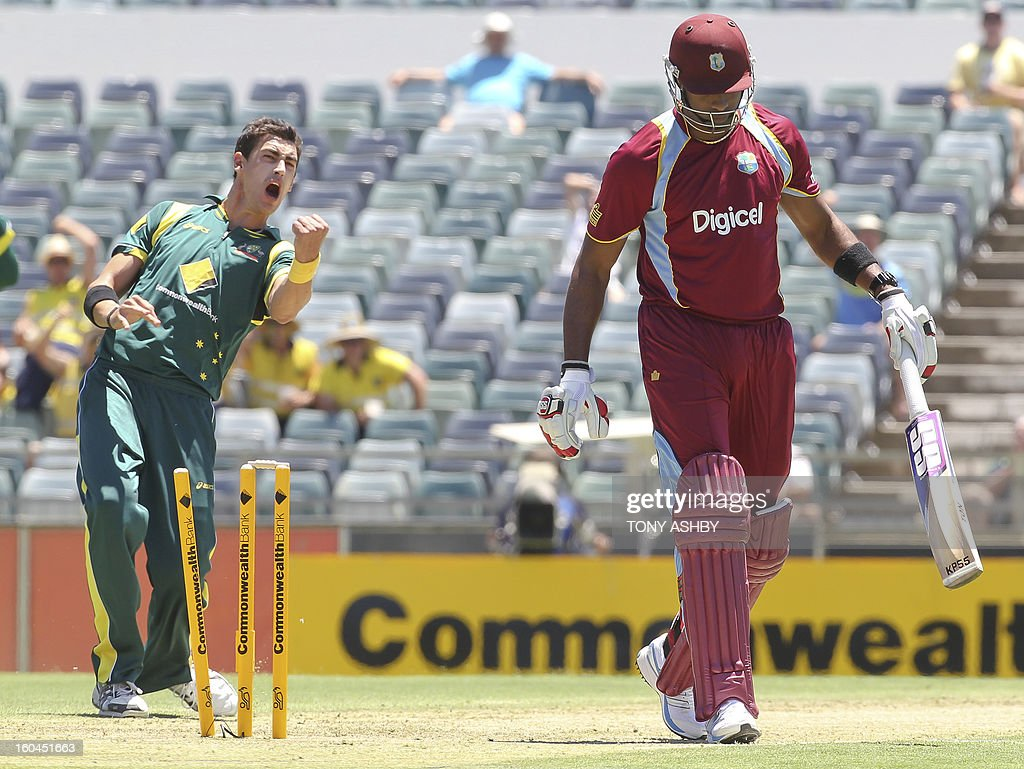 Australia's fast bowler Mitchell Starc (L) celebrates taking the wicket of West Indies batsman Kieron Pollard (R) during the one-day international cricket match between Australia and the West Indies at the WACA ground on February 1, 2013. AFP PHOTO/Tony ASHBY IMAGE