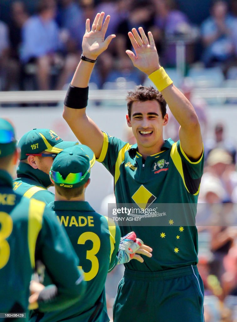 Australia's fast bowler Mitchell Starc (R) celebrates with teamates after taking five wickets for 20 runs at the conclusion of the one-day international cricket match between Australia and the West Indies at the WACA ground on February 1, 2013. AFP PHOTO/Tony ASHBY USE