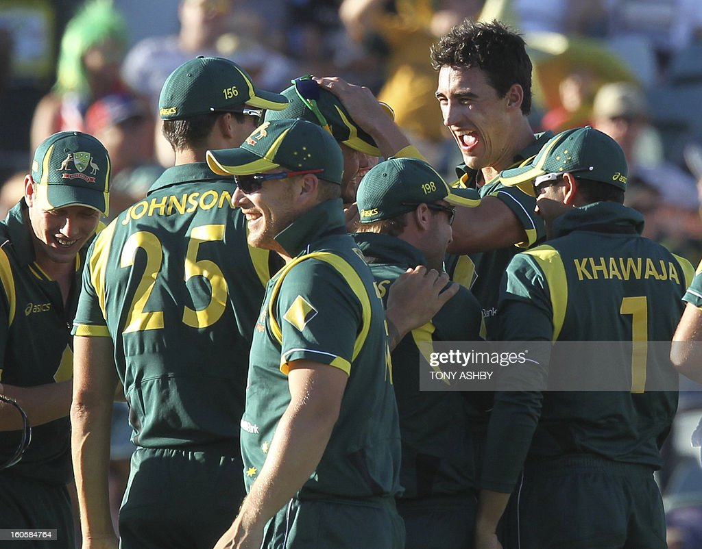 Australia's fast bowler Mitchell Starc (2nd) is congratulated by teamates after taking five wickets during the one-day international cricket match between Australia and the West Indies at the WACA ground in Perth on February 3, 2013. AFP PHOTO/Tony ASHBY USE