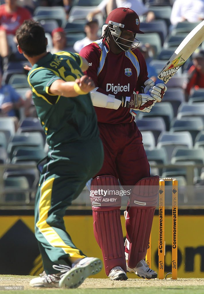 Australia's fast bowler Mitchell Starc (L) reacts to trapping West Indies batsman Chris Gayle (R) LBW during the one-day international cricket match between Australia and the West Indies at the WACA ground in Perth on February 3, 2013. AFP PHOTO/Tony ASHBY USE