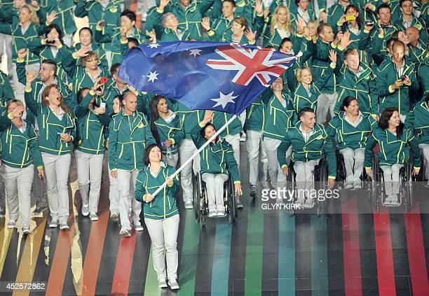 Australia's flagbearer Anna Meares leads the delegation during the opening ceremony of the 2014 Commonwealth Games at Celtic Park in Glasgow on July...