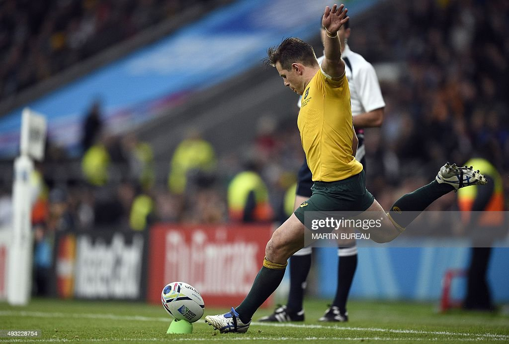 Australia's fly half Bernard Foley converts his team's fourth try during a quarter final match of the 2015 Rugby World Cup between Australia and...