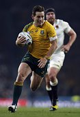Australia's fly half Bernard Foley runs to score the second try during a Pool A match of the 2015 Rugby World Cup between England and Australia at...
