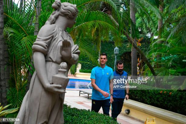Australia's footballer Tomi Juric arrives to meet the press at the hotel in San Pedro Sula Honduras on November 8 2017 just days ahead of the first...