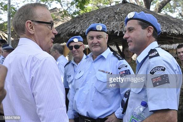 Australia's Foreign Minister Bob Carr meets Australian police deployed under the UN peace keeping mission in East Timor during a visit in Dili on...