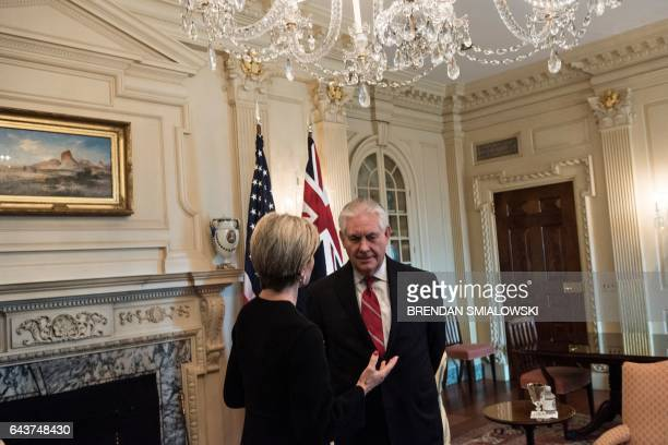 Australia's Foreign Minister Julie Bishop and US Secretary of State Rex W Tillerson talk before a meeting at the US State Department on February 22...