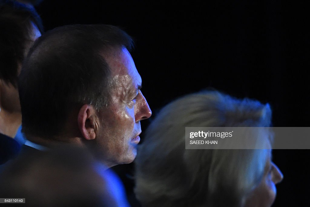 Australia's former prime minister Tony Abbott listens to Prime Minister Malcolm Turnbull's address at the Coalition Campaign Launch in Sydney on June 26, 2016. Australia's prime minister promised stability and strong economic policy in the wake of global turmoil sparked by Britain's Brexit vote, as he campaigned June 26 ahead of next week's national polls. / AFP / SAEED