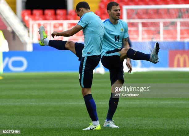 Australia's forward James Troisi and a teammate take part in a training session at the Spartak Stadium in Moscow on June 24 2017 on the eve of the...