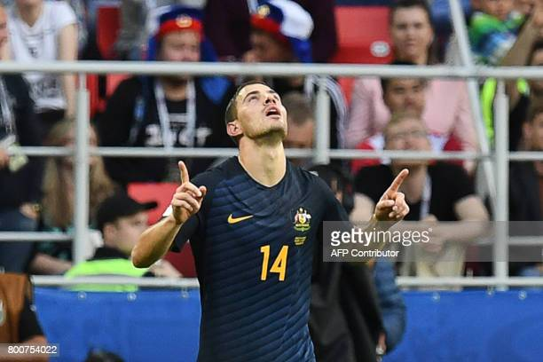 Australia's forward James Troisi celebrates after scoring during the 2017 Confederations Cup group B football match between Chile and Australia at...