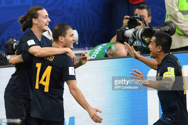 Australia's forward James Troisi celebrates scoring with team mates during the 2017 Confederations Cup group B football match between Chile and...