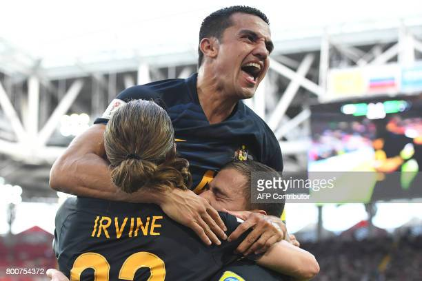 Australia's forward James Troisi celebrates with Australia's forward Tim Cahill and Australia's midfielder Jackson Irvine after scoring during the...