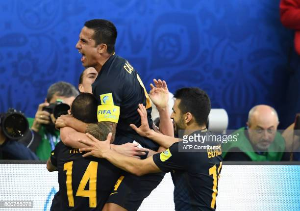 Australia's forward James Troisi celebrates with Australia's forward Tim Cahill after scoring during the 2017 Confederations Cup group B football...