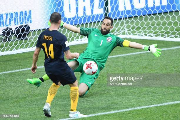 TOPSHOT Australia's forward James Troisi scores in the nets of Chile's goalkeeper Claudio Bravo during the 2017 Confederations Cup group B football...