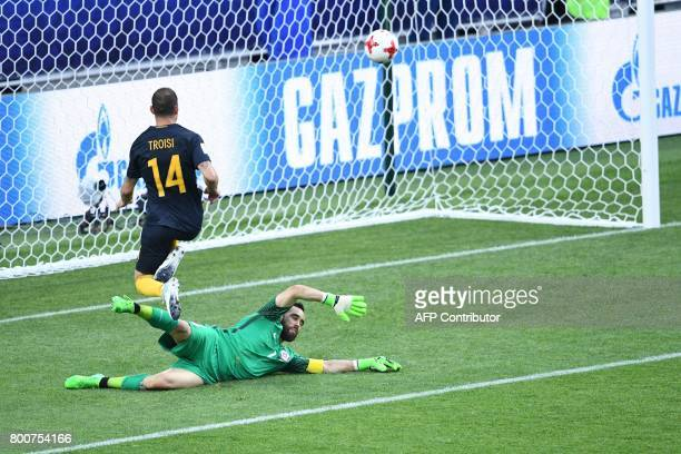 Australia's forward James Troisi scores in the nets of Chile's goalkeeper Claudio Bravo during the 2017 Confederations Cup group B football match...