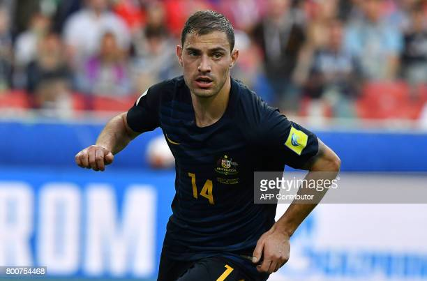 Australia's forward James Troisi scores the first goal during the 2017 Confederations Cup group B football match between Chile and Australia at the...