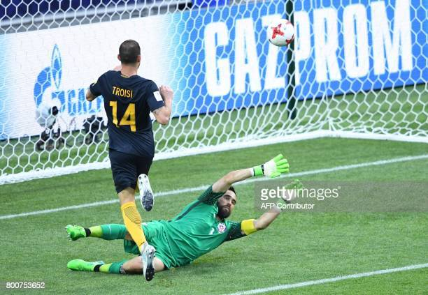 Australia's forward James Troisi scores the first goal in the nets of Chile's goalkeeper Claudio Bravo during the 2017 Confederations Cup group B...
