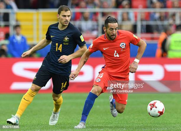 Australia's forward James Troisi vies with Chile's defender Mauricio Isla during the 2017 Confederations Cup group B football match between Chile and...