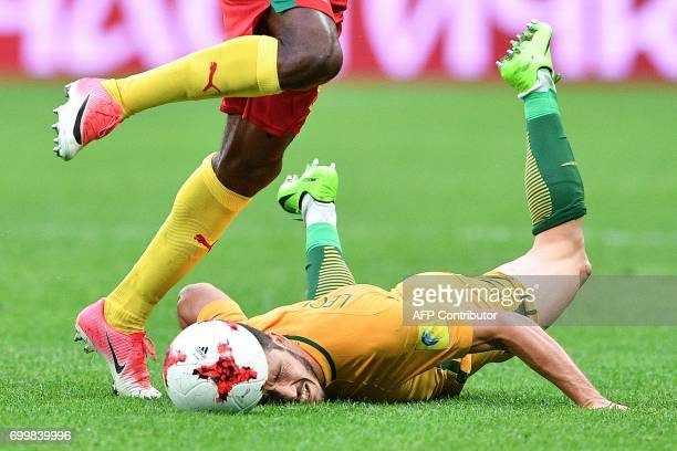 TOPSHOT Australia's forward Mathew Leckie lies on the pitch during the 2017 Confederations Cup group B football match between Cameroon and Australia...