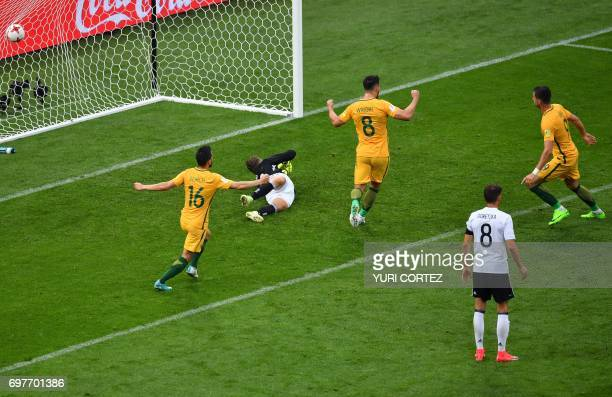 TOPSHOT Australia's forward Tomi Juric celebrates after scoring a goal during the 2017 Confederations Cup group B football match between Australia...