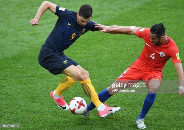 Australia's forward Tomi Juric Chile's defender Mauricio Isla with YYY during the 2017 Confederations Cup group B football match between Chile and...