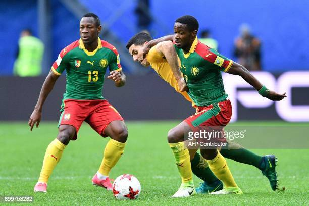 Australia's forward Tomi Juric is tackled by Cameroon's midfielder Arnaud Djoum during the 2017 Confederations Cup group B football match between...
