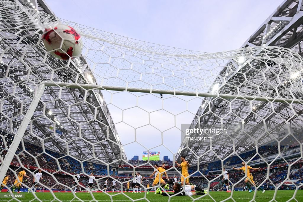 TOPSHOT - Australia's forward Tomi Juric scores a goal past Germany's goalkeeper Bernd Leno during the 2017 Confederations Cup group B football match between Australia and Germany at the Fisht Stadium in Sochi on June 19, 2017. /