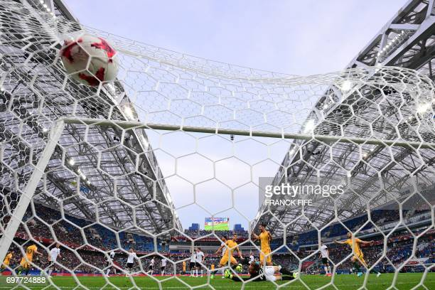TOPSHOT Australia's forward Tomi Juric scores a goal past Germany's goalkeeper Bernd Leno during the 2017 Confederations Cup group B football match...