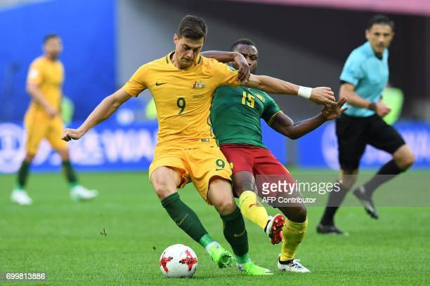 Australia's forward Tomi Juric vies for the ball against Cameroon's midfielder Sebastien Siani during the 2017 Confederations Cup group B football...