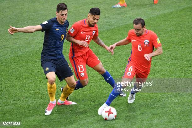 Australia's forward Tomi Juric vies with Chile's defender Paulo Diaz and Chile's midfielder Jose Fuenzalida during the 2017 Confederations Cup group...