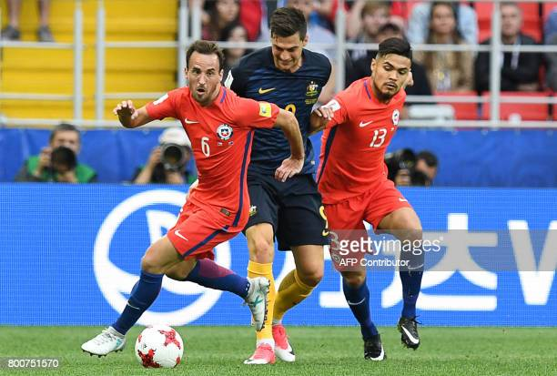 Australia's forward Tomi Juric vies with Chile's midfielder Jose Fuenzalida and Chile's defender Paulo Diaz during the 2017 Confederations Cup group...