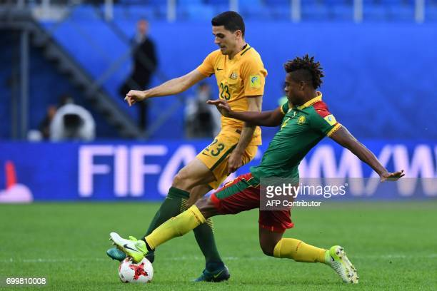 Australia's forward Tommy Rogic vies for the ball against Cameroon's defender Adolphe Teikeu during the 2017 Confederations Cup group B football...