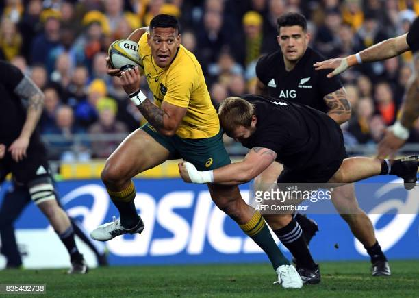 TOPSHOT Australia's fullback Israel Folau is tackled by New Zealand's hooker Codie Taylor during the Rugby Championship test match between Australia...