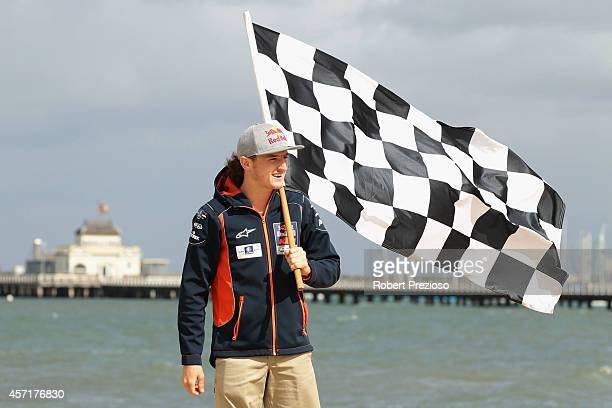 Australia's future star of MotoGP Jack Miller poses with the chequered flag after cooking an Aussie BBQ on the foreshore of St Kilda Sea Baths on...