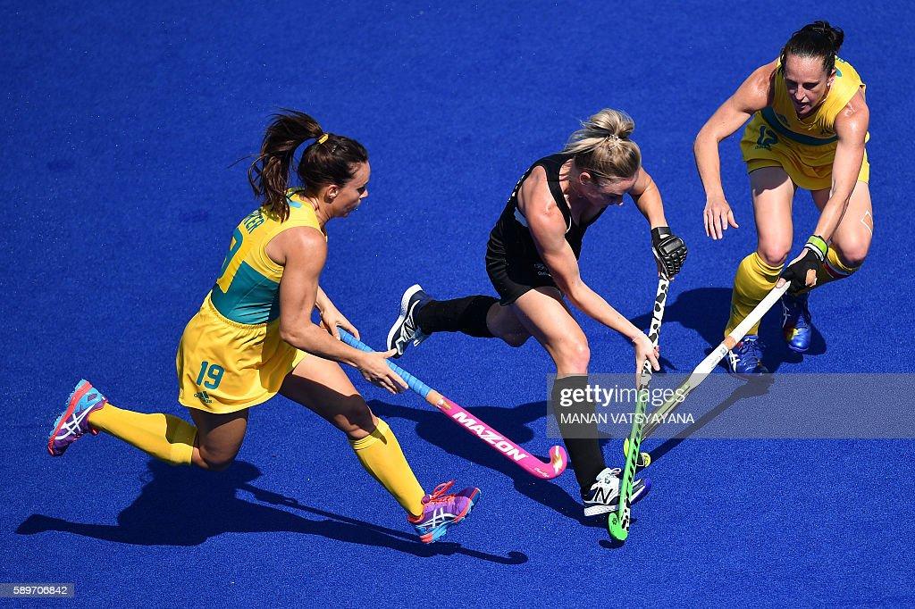 Australia's Georgie Parker and Australia's Madonna Blyth vies with New Zealand's Anita McLaren during the the women's quarterfinal field hockey New...