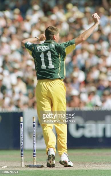 Australia's Glen McGrath runs out England's Robert Croft for 2