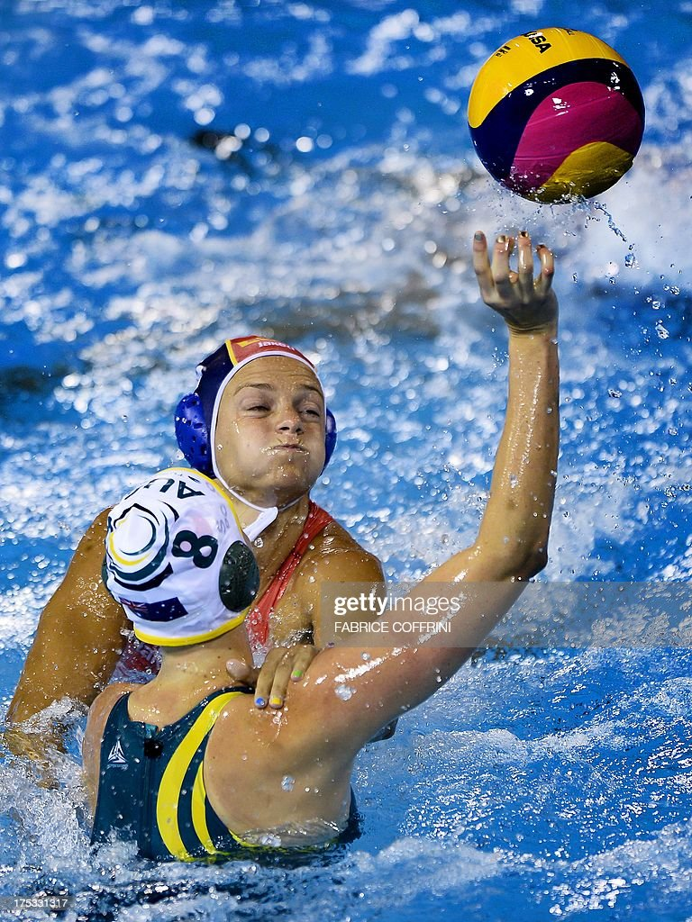 Australia's Glencora McGhie vies Spain's Jennifer Pareja during their women's water polo gold medal match at the FINA World Championships at the...