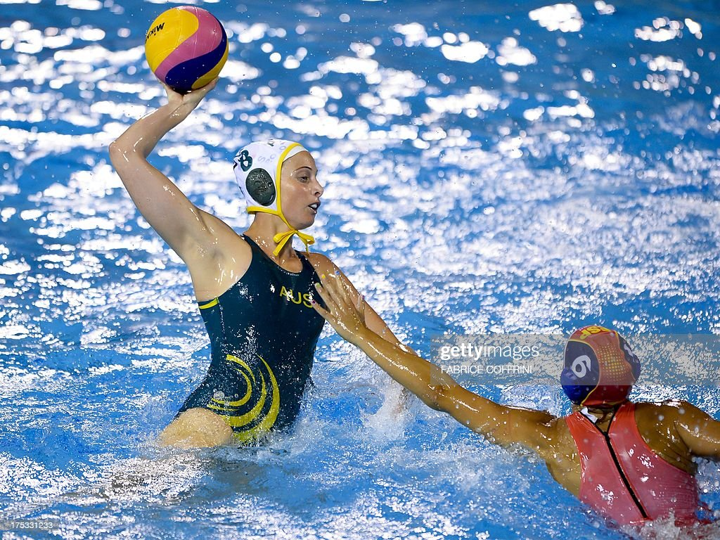 Australia's Glencora McGhie vies with Spain's Jennifer Pareja during their women's water polo gold medal match at the FINA World Championships at the...