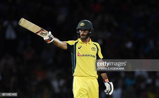 Australia's Glenn Maxwell celebrates 50 runs during the final T20 international cricket match between Sri Lanka and Australia at the R Premadasa...