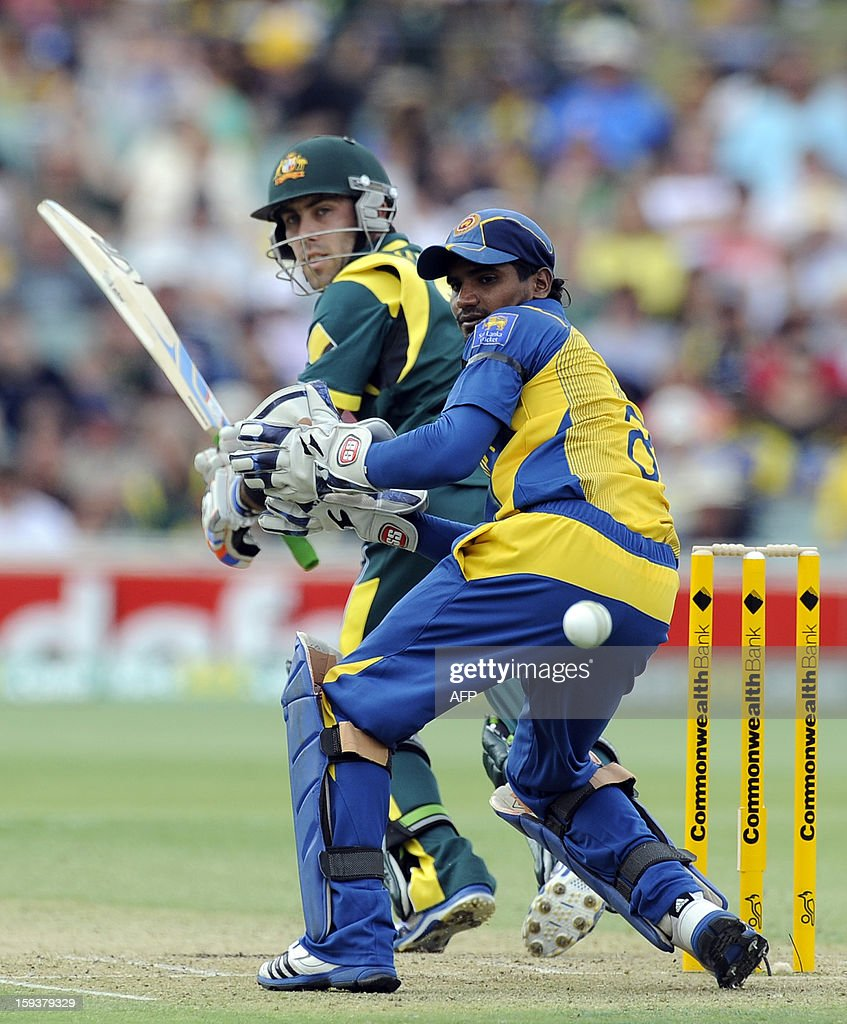 Australia's Glenn Maxwell (L) hits a ball past Sri Lanka's Kushal Janith Perera (R) during their one-day international cricket match at the Adelaide Oval on January 13, 2013. AFP PHOTO / David Mariuz USE