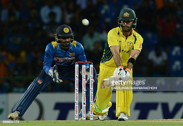 Australia's Glenn Maxwell is watched by Sri Lanka's wicketkeeper Kusal Perera as he hits a shot during the first T20 international cricket match...