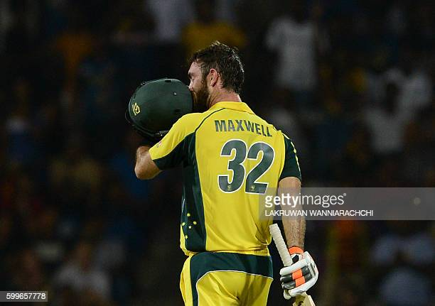 Australia's Glenn Maxwell kisses his helmet after scoring a century during the first T20 international cricket match between Sri Lanka and Australia...