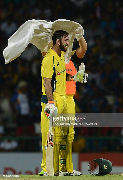 Australia's Glenn Maxwell takes a drink break during the first T20 international cricket match between Sri Lanka and Australia at the Pallekele...