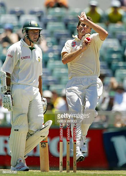 Australia's Glenn McGrath prepares to bowl as South African captain Graeme Smith stands alongside during the first Test in Perth 17 December 2005 At...