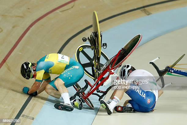 TOPSHOT Australia's Glenn O'Shea and Italy's Elia Viviani fall after crashing in the Men's Omnium Points race track cycling event at the Velodrome...