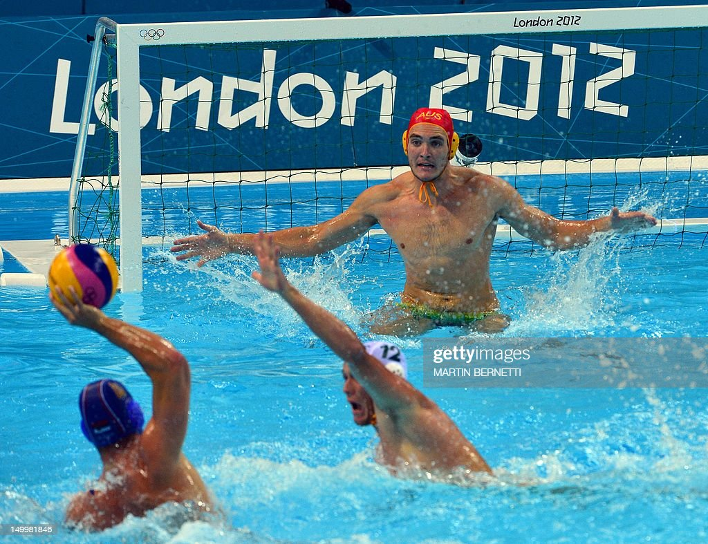 Australia's goalkeeper Joel Dennerley attempts a shot at goal against Serbia's Vanja Udovicic during the men's water polo quarterfinal match between...