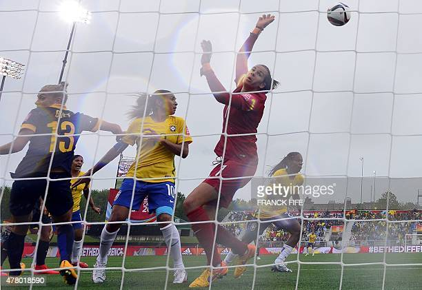Australia's goalkeeper Lydia Williams makes a stop during their 2015 FIFA Women's World Cup round of 16 match against Brazil at Moncton Stadium in...