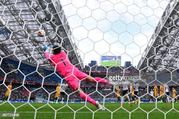 Australia's goalkeeper Mathew Ryan dives to block a shot on goal during the 2017 Confederations Cup group B football match between Australia and...