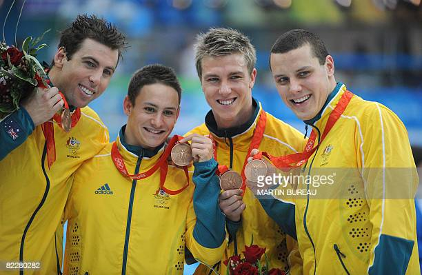 Australia's Grant Hackett Nick Frost Grant Brits and Patrick Murphy pose with their bronze medal after the men's 4 x 200m freestyle relay swimming...
